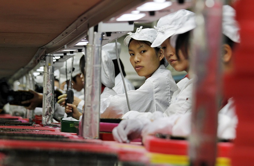 File photo of workers inside a Foxconn factory in the township of Longhua in the southern Guangdong province